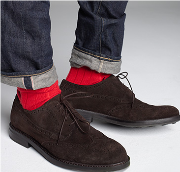 Wearing bright orange socks with suede oxfords and jeans.