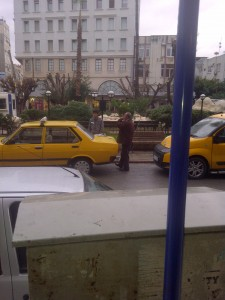 Another typical Turkish scene- drinking tea from a tray off the back of a taxi.