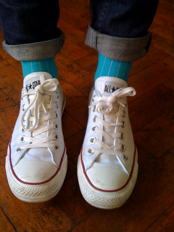 Wearing bright blue socks with jeans and chuck taylors