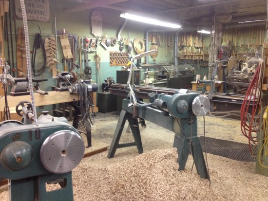 Lathes and shavings on the shop floor.