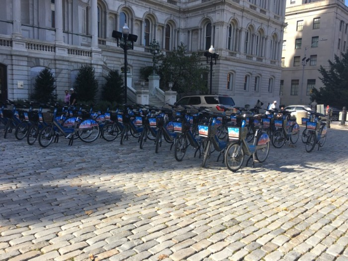 Dozens of bikes sit outside city hall hours after the mayor's photo op.
