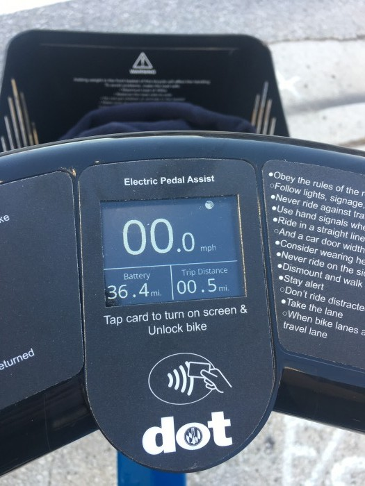 The digital readout seen on this electric model is the same on the geared model but without the words 'electric pedal assist.' This is the view riding, making it impossible to see the wheel.